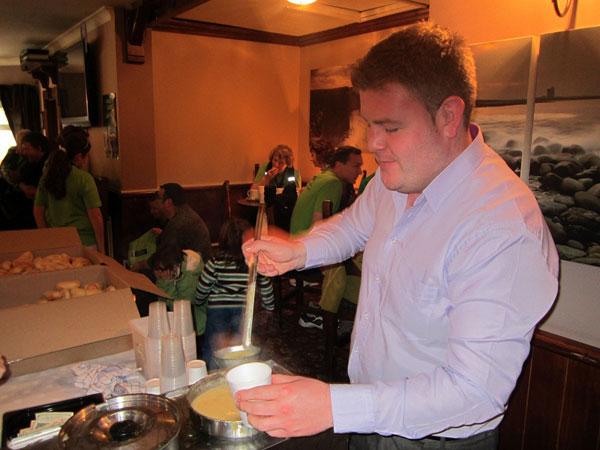T Kierran serving soup